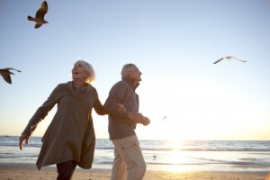 Living_in_Portugal_TaxExemptions_HappyRetiredCouple2_Beach